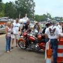Motorcycle enthusiasts gather in downtown Sturgis. KNKL announcers offer public safety over the Technomad loudspeakers as inclement weather and other situations arise. Photo credit to Jimmy Smith.