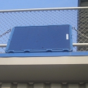 Technomad offers 14 custom colors that do not fade in sunlight. this photo shows two custom blue Berlin loudspeakers mounted to the press box at Middle Tennessee State University stadium.